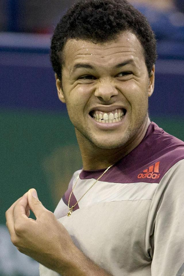 France's Jo-Wilfried Tsonga reacts to a lost point during the singles semifinal match against Serbia's Novak Djokovic at the Shanghai Masters tennis tournament at the Qizhong Forest Sports City Tennis Center in Shanghai, China on Saturday, Oct. 12, 2013. Djokovic won 6-2, 7-5. (AP Photo/Ng Han Guan)