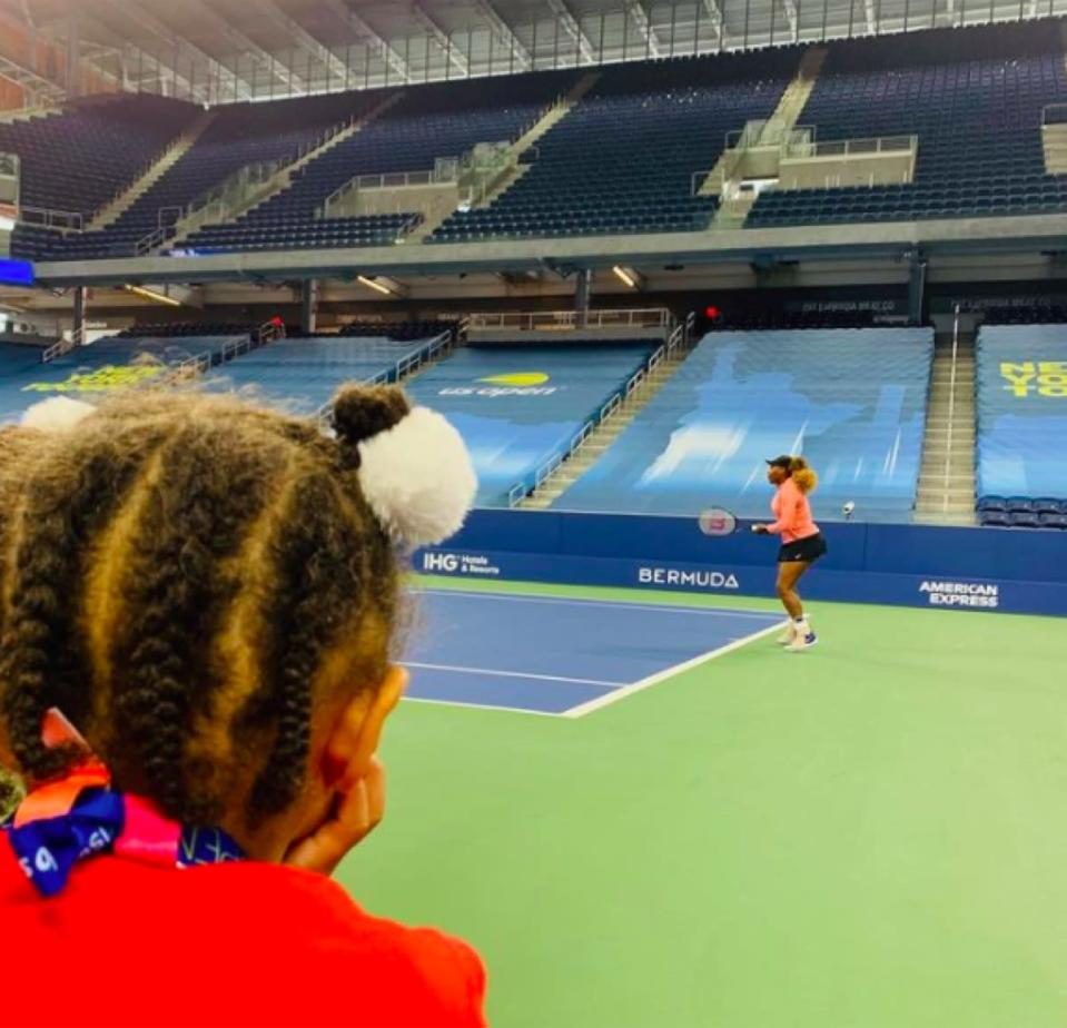 Serena Williams' daughter watching her play tennis