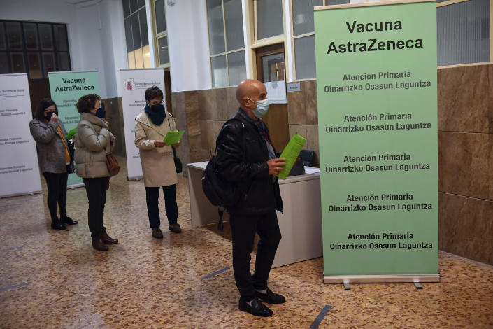 People queue to receive a shot of the Astrazeneca vaccine, during a COVID-19 vaccination campaign in Pamplona, northern Spain, Sunday, April 11, 2021. The Navarra regional government called for around 3,000 residents of the city to be vaccinated against COVID-19 this weekend. (AP Photo/Alvaro Barrientos)