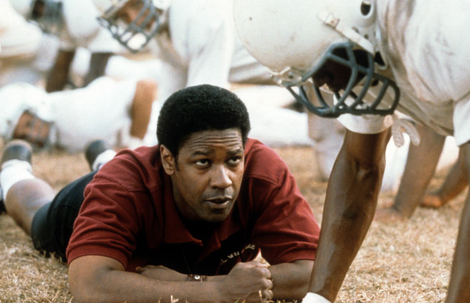 Denzel Washington motivates football players in a scene form the film 'Remember The Titans', 2000. (Photo by Buena Vista/Getty Images)