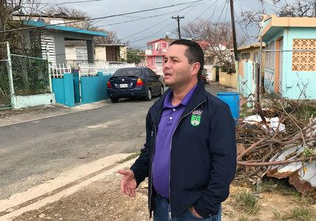 Angel Perez, the mayor of suburban Guaynabo, Puerto Rico, assesses Hurricane Maria's damage in the Vietnam section of Guaynabo, Puerto Rico on October 1, 2017. Picture taken on October 1, 2017.  REUTERS/Nick Brown