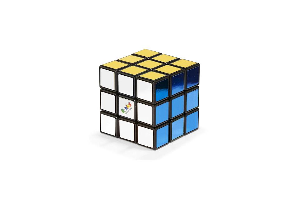 """$18, MoMA Design. <a href=""""https://store.moma.org/gifts/under-25/rubik%E2%80%99s-cube-40th-anniversary-metallic-edition/13236-153009.html?cgid=gifts-under-25"""" rel=""""nofollow noopener"""" target=""""_blank"""" data-ylk=""""slk:Get it now!"""" class=""""link rapid-noclick-resp"""">Get it now!</a>"""