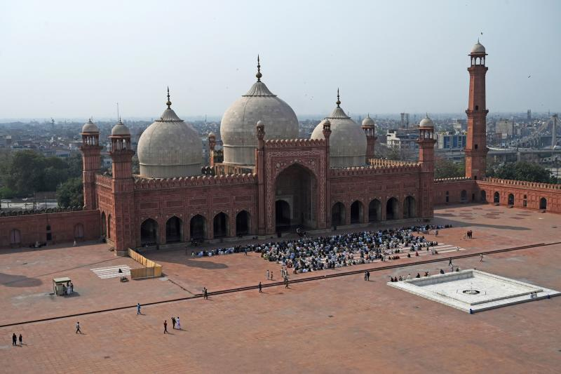 Muslims prepare to offer Friday prayers at partially empty historical Badshahi mosque amid concerns over the spread of the COVID-19 novel coronavirus, in Lahore on March 20, 2020. (Photo by ARIF ALI / AFP) (Photo by ARIF ALI/AFP via Getty Images)