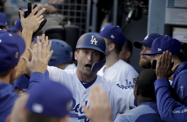 FILE - In this Oct. 28, 2018, file photo, Los Angeles Dodgers' David Freese celebrates in the dugout after hitting a home run against the Boston Red Sox during the first inning in Game 5 of the World Series baseball game in Los Angeles. Freese is retiring after a 10-year career that included a World Series title in 2011 with the St. Louis Cardinals when he was MVP. The 36-year-old infielder made the announcement Saturday, Oct. 12, 2019, on his verified Twitter account. (AP Photo/Jae C. Hong, File)