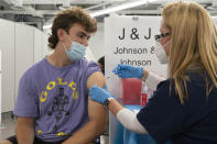 FILE - In this July 30, 2021, file photo, Bradley Sharp, of Saratoga, N.Y., gets the Johnson & Johnson vaccine from registered nurse Stephanie Wagner in New York. Starting Thursday, Oct. 14, 2021, the Food and Drug Administration convenes its independent advisers for the first stage in the process of deciding whether extra shots of Moderna or Johnson & Johnson vaccines should be dispensed and, if so, who should get them and when. (AP Photo/Mark Lennihan, File)
