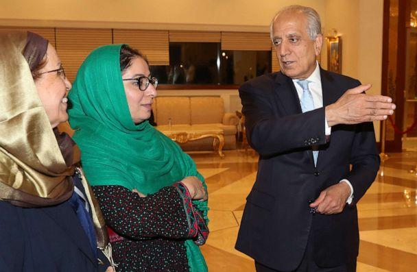 PHOTO: US Special Representative for Afghanistan Reconciliation Zalmay Khalilzad speaks with Asila Wardak during the Intra Afghan Dialogue talks in the Qatari capital Doha on July 8, 2019. (Karim Jaafar/AFP/Getty Images)
