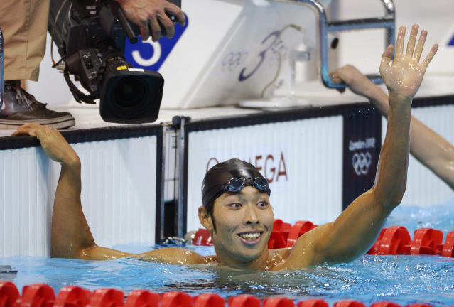 Japan's Kosuke Hagino reacts after placing first in a men's 400-meter individual medley heat at the Aquatics Centre in the Olympic Park during the 2012 Summer Olympics in London, Saturday, July 28, 2012. (AP Photo/Mark J. Terrill)