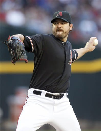 Arizona Diamondbacks pitcher Joe Saunders winds up to deliver against the Atlanta Braves in the first inning of a baseball game in Saturday, April 21, 2012, in Phoenix. (AP Photo/Paul Connors)