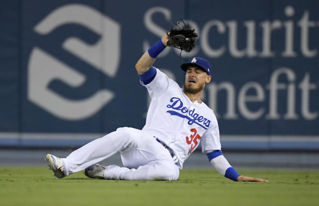 Los Angeles Dodgers' Cody Bellinger makes the catch on a ball hit by Arizona Diamondbacks' Jarrod Dyson during the seventh inning of a baseball game Friday, Aug. 9, 2019, in Los Angeles. (AP Photo/Mark J. Terrill)