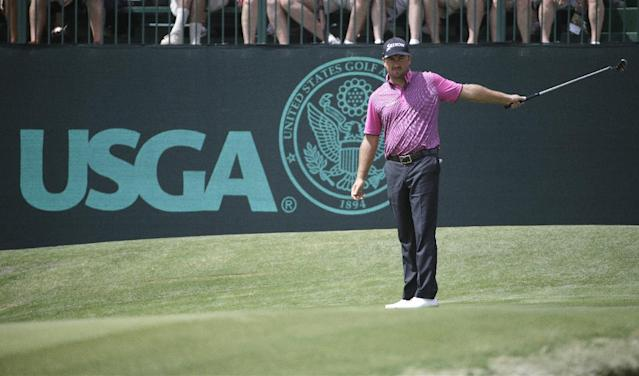 Graeme McDowell, of Northern Ireland, watches his putt on the 13th hole during the first round of the U.S. Open golf tournament in Pinehurst, N.C., Thursday, June 12, 2014. (AP Photo/David Goldman)