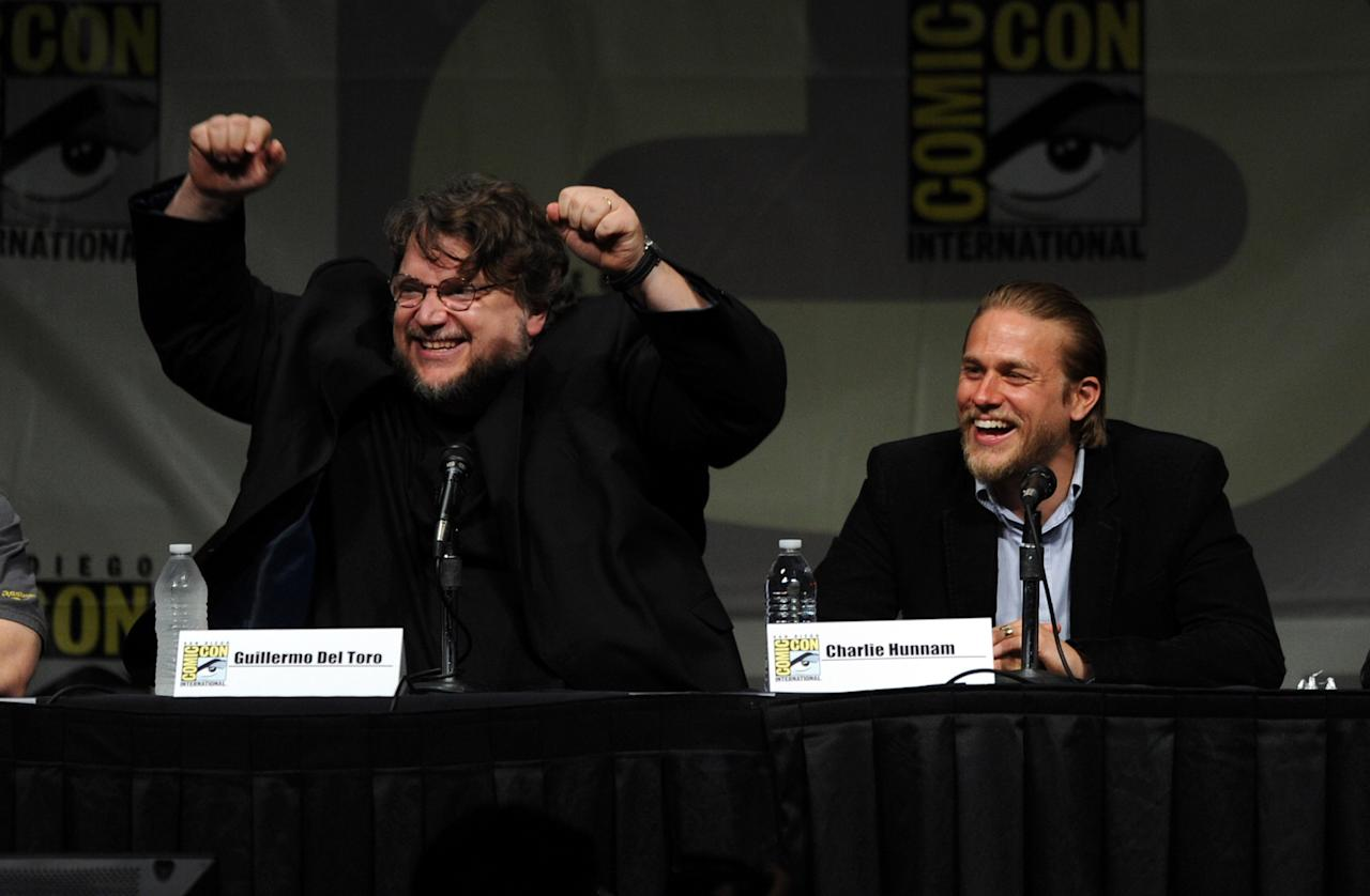 "SAN DIEGO, CA - JULY 14:  Director Guillermo del Toro (L) and actor Charlie Hunnam speak at Warner Bros. Pictures and Legendary Pictures Preview of ""Pacific Rim"" during Comic-Con International 2012 at San Diego Convention Center on July 14, 2012 in San Diego, California.  (Photo by Kevin Winter/Getty Images)"