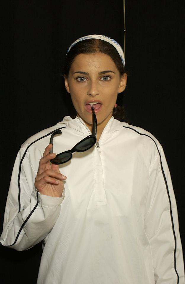 <p>Nelly Furtado wears a white track suit, headband, and sunglasses backstage at the MTV 2001 Video Music Awards in New York City.</p>