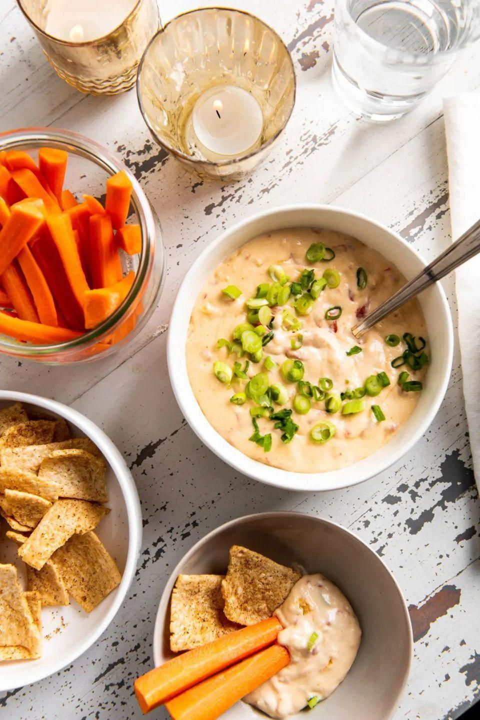 """<p>Pop this Southern staple into the slow cooker for a warm dip that's great for the holidays. You can serve it with veggies or your favorite crackers. </p><p><strong>Get the recipe at <a href=""""https://themom100.com/recipe/easy-slow-cooker-hot-pimento-cheese-dip/"""" rel=""""nofollow noopener"""" target=""""_blank"""" data-ylk=""""slk:The Mom 100"""" class=""""link rapid-noclick-resp"""">The Mom 100</a>.</strong></p>"""