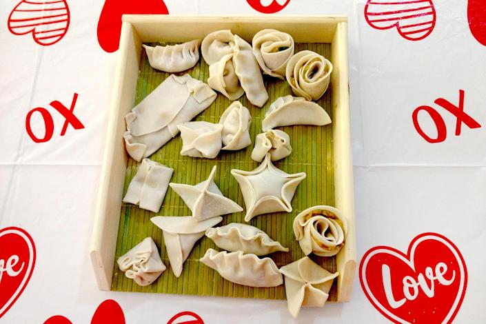 Various folds of dumplings on a tray (Courtesy Yin Yang)