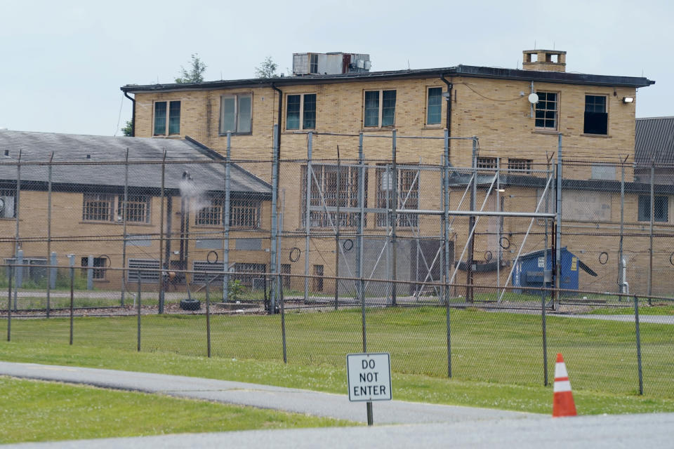 High fences surround buildings on the grounds of the Edna Mahan Correctional Facility for Women in Clinton, N.J., Tuesday, June 8, 2021. New Jersey's embattled corrections commissioner announced his resignation Tuesday, a day after Gov. Phil Murphy said the state would shutter its long-troubled and only women's prison. (AP Photo/Seth Wenig)