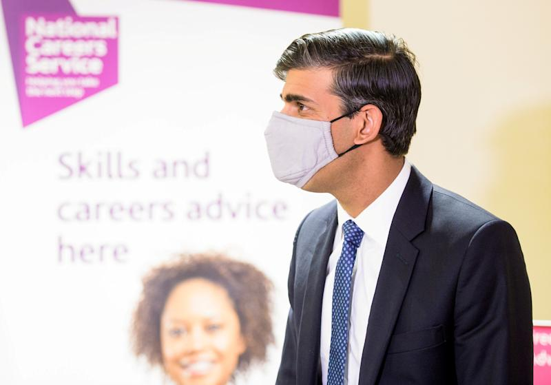 Britain's Chancellor of the Exchequer Rishi Sunak wearing a face mask visits the Jobcentre Plus to see the new support being provided in job centres by the doubling of work coaches, following the coronavirus disease (COVID-19) outbreak in Barking, London, Britain July 16, 2020. Anthony Upton/Pool via REUTERS