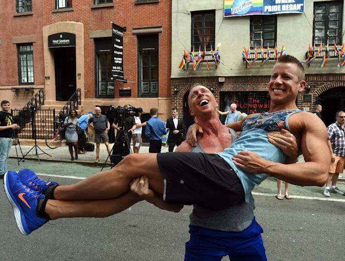 Justin Kattler and Tim Loecker from Dallas, Texas celebrate the Supreme Court's ruling on gay marriage outside the Stonewall Tavern in the West Village in New York on June 26, 2015 (AFP Photo/Timothy A. Clary)