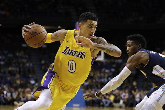 "Lakers forward <a class=""link rapid-noclick-resp"" href=""/ncaab/players/126328/"" data-ylk=""slk:Kyle Kuzma"">Kyle Kuzma</a> beats Nuggets guard <a class=""link rapid-noclick-resp"" href=""/nba/players/5650/"" data-ylk=""slk:Malik Beasley"">Malik Beasley</a> off the dribble. (AP)"