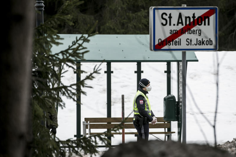 LANDECK, AUSTRIA - MARCH 14: Police at a roadblock near Sankt Anton following the imposition of a quarantine due to the coronavirus on March 14, 2020 near Landeck, Austria. The ski resort towns of Sankt Anton and Ischgl are both under quarantine and many ski resorts in the region have been closed. The Austrian government is pursuing aggressive measures, including closing schools, cancelling events and shuttering shops except for grocery stores and pharmacies in an effort to slow the ongoing spread of the coronavirus. (Photo by Jan Hetfleisch/Getty Images)