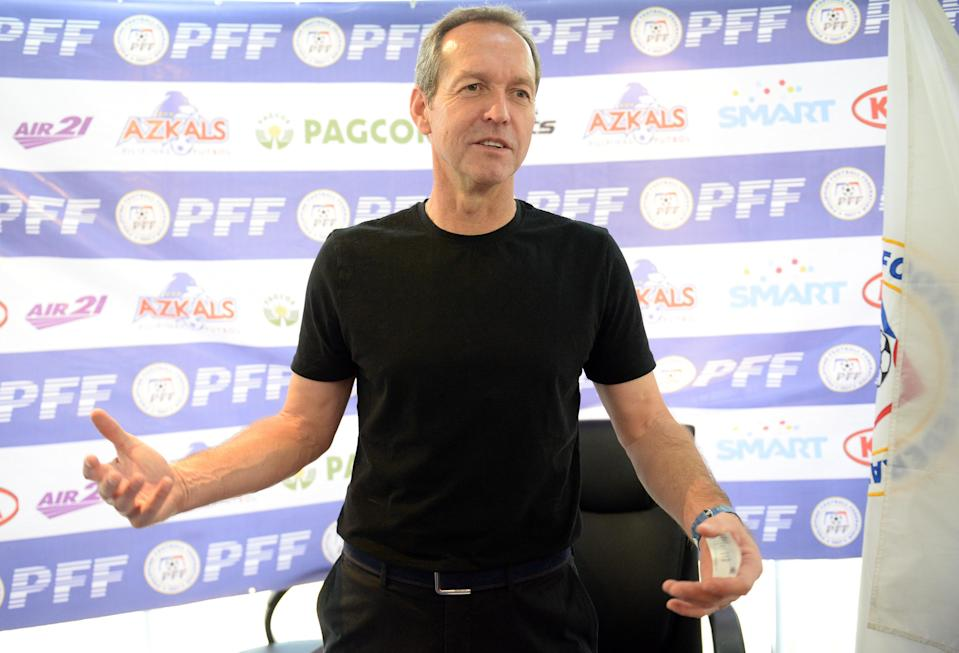 Thomas Dooley, head coach of the Philippines' national team, poses for photos during a press conference in Manila, on February 7, 2014 (AFP Photo/Ted Aljibe)