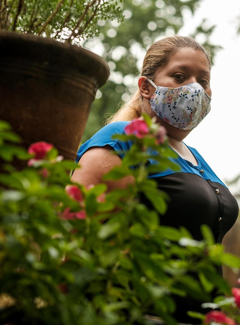 Image: Karen Salazar outside of her mother's home in Houston on July 7, 2020. (Fred Agho / for NBC News)