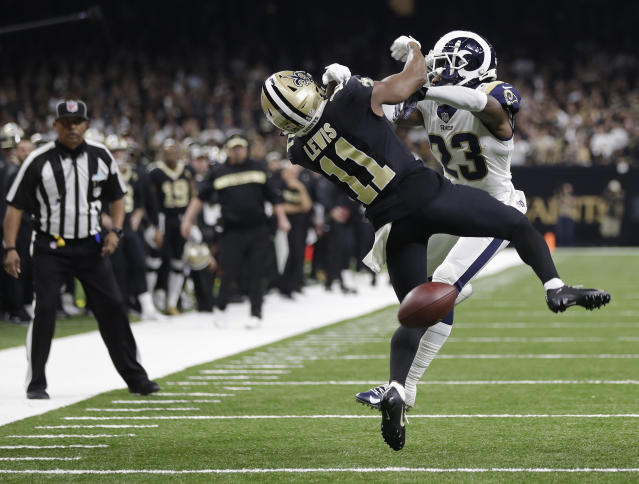 FILE-In this Sunday, Jan. 20, 2019 file photo, New Orleans Saints wide receiver Tommylee Lewis (11) works for a catch against Los Angeles Rams defensive back Nickell Robey-Coleman (23) during the second half the NFL football NFC championship game, in New Orleans. The Rams won 26-23. New Orleans Saints fans have found some pretty creative ways to express their displeasure over the infamous no call during last weekends Saints-Rams championship game. But their newest tactic may make the loudest statement - a Super Bowl boycott. (AP Photo/Gerald Herbert, File)