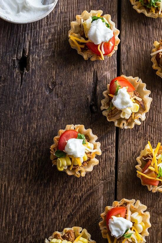 """<p>The best part about these <a rel=""""nofollow"""" href=""""https://www.popsugar.com/food/Mini-Chicken-Taco-Bites-35992582"""">chicken taco bites</a> (aside from their adorable bite-size presentation) is that the filling comes together in a slow cooker. </p>"""