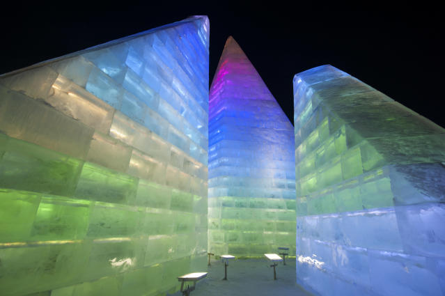 <p>Tourists visit illuminated ice sculptures at Ice and Snow World park on Jan. 4 in Harbin, China. (Photo: Tao Zhang/Getty Images) </p>
