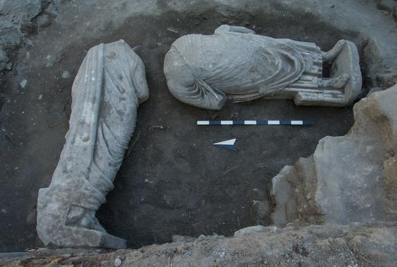 Two headless Roman-era statues were recycled by medieval builders as foundation material.