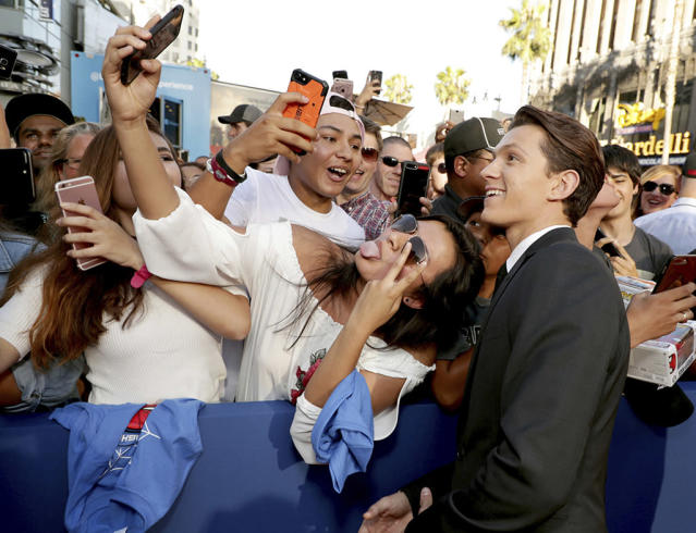 """<p>Spidey actor shares the moment with the fans at the <a href=""""https://www.yahoo.com/movies/film/spider-man-homecoming"""" data-ylk=""""slk:Spider-Man: Homecoming"""" class=""""link rapid-noclick-resp""""><em>Spider-Man: Homecoming</em></a> premiere at TCL Chinese Theatre on June 28, 2017, in Hollywood. (Photo: Eric Charbonneau/Invision/AP Images) </p>"""