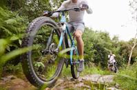 <p>Get your cardio in by hitting the great outdoors on a bike. Spending a few hours biking along trails will do more than rev up your metabolism. It'll challenge your balance and athleticism as you react to varied terrain. </p><p>It's a perfect way to get outside, too, giving your body a much-needed dose of fresh air. </p>