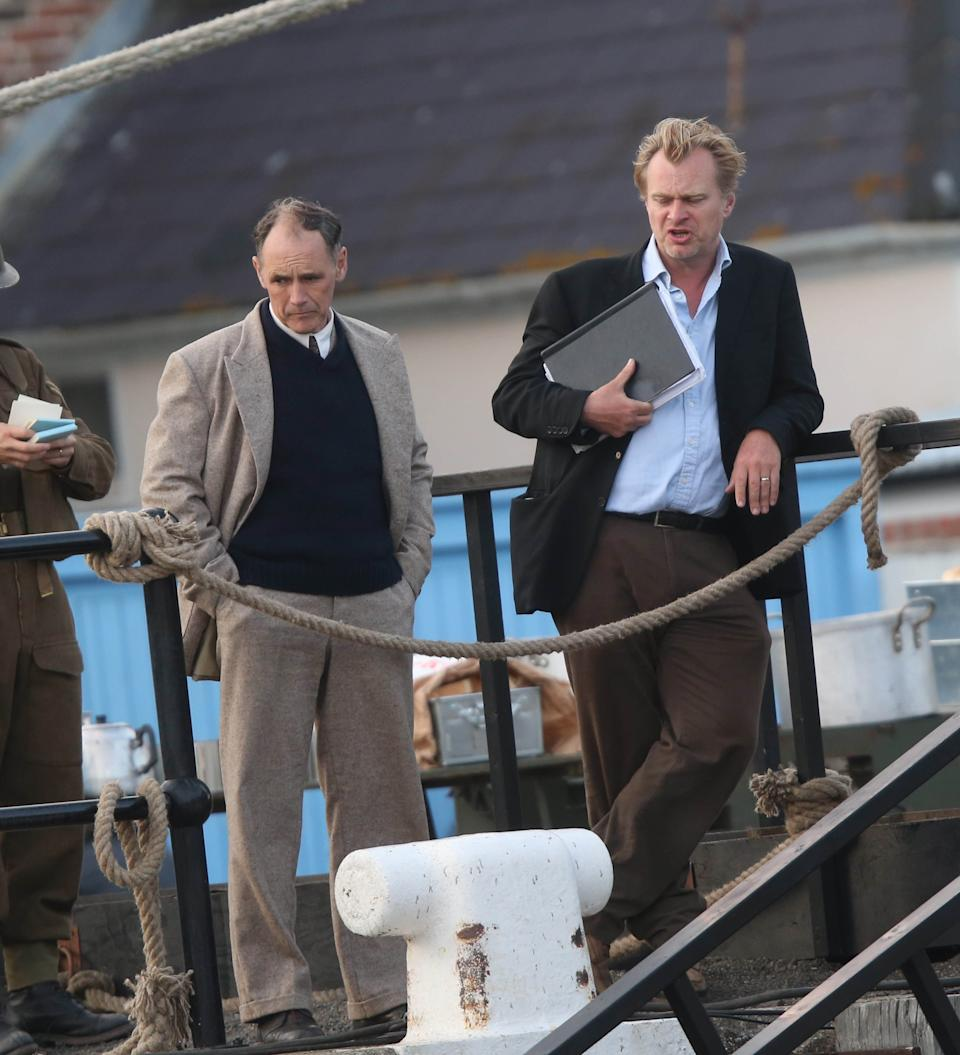 """Photo by: KGC-49-182/STAR MAX/IPx 7/27/16 Harry Styles, Cillian Murphy, Mark Rylance and director Christopher Nolan on the set of """"Dunkirk"""".  This is Harry's first big movie role as a world war 2 soldier. (Weymouth, South West England)"""