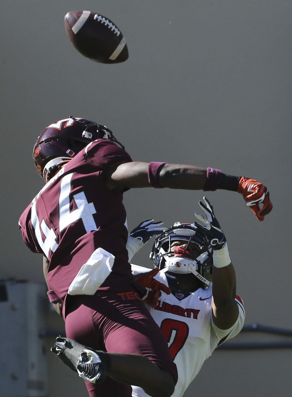 Virginia Tech's Dorian Strong breaks up a pass intended for Liberty wide receiver Kevin Shaa during the first half of an NCAA college football game, Saturday, Nov. 7 2020, in Blacksburg, Va. (Matt Gentry/The Roanoke Times via AP, Pool)