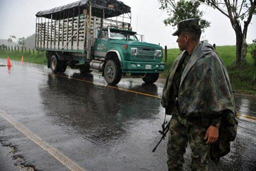 Colombian soldiers man a checkpoint along a highway of La Montanita municipality