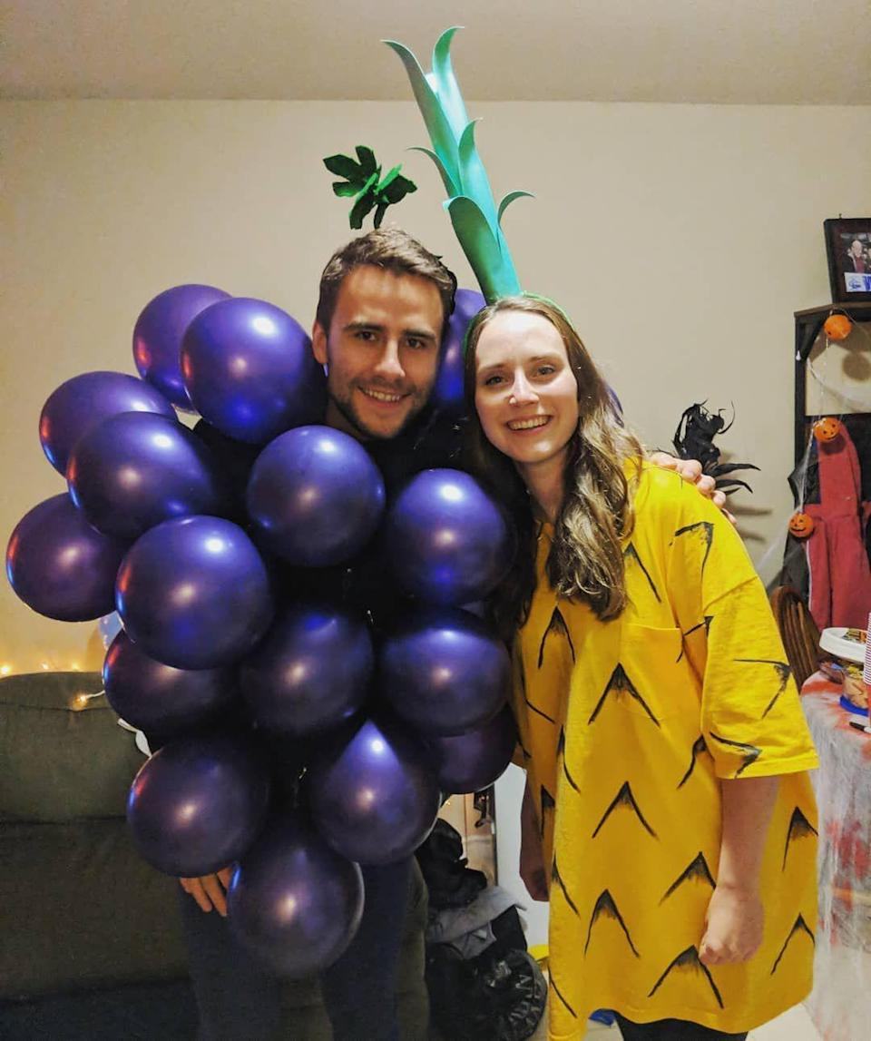 <p>Enjoy a fruit-ful Halloween this year and dress up like grapes and a pineapple like this couple. </p>