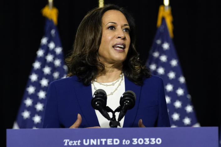 FILE - In this Aug. 12, 2020, file photo, Sen. Kamala Harris, D-Calif., speaks after Democratic presidential candidate former Vice President Joe Biden introduced her as his running mate during a campaign event at Alexis Dupont High School in Wilmington, Del. After following her career for years, Harris' extended family in Jamaica is elated at their relative's rise to a historic nomination. (AP Photo/Carolyn Kaster, File)