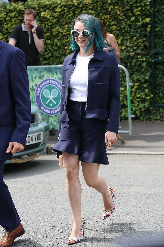 <p>The Game of Thrones start wore a navy short suit for the event. </p>