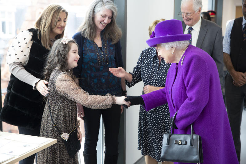 RETRANSMITTING WITH UPDATED CAPTION INFORMATION Queen Elizabeth II meeting eight year old Lily Conlan, a cochlear implant patient, as she officially opens the new premises of the Royal National ENT and Eastman Dental Hospitals in London.