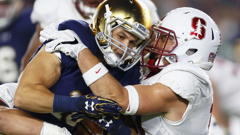 Chris Finke of Notre Dame, pictured here being tackled by Zach Hoffpauir of the Stanford Cardinal in 2016.