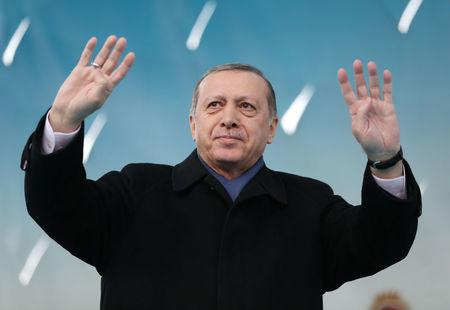 Turkish President Erdogan greets his supporters during a ceremony in Afyonkarahisar