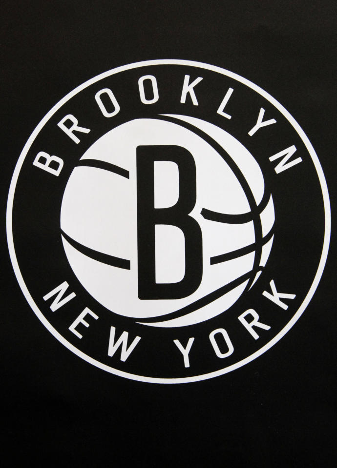 One of the new Brooklyn Nets logos is displayed during a news conference in the Brooklyn borough of New York, Monday, April 30, 2012. The Nets will be moving from New Jersey to the new Barclays Center in Brooklyn for the 2012-2013 NBA basketball season. (AP Photo/Seth Wenig)