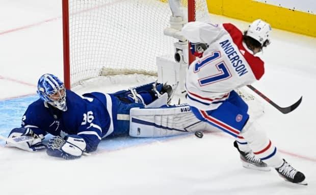 Toronto Maple Leafs goaltender Jack Campbell makes a save on Montreal Canadiens forward Josh Anderson in their contest May 20. Campbell will be starting in the first playoff Game 7 of his career.