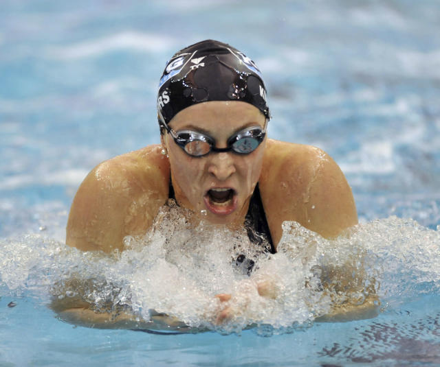 FILE - In this Dec. 6, 2008, file photo, Ariana Kukors swims to win the Women's 200-yard breaststroke finals during the 2008 USA Swimming Short Course National Championships at the Georgia Tech Aquatic Center in Atlanta. Olympic swimmer Kukors Smith sued USA Swimming on Monday, May 21, 2018, alleging the sport's national governing body knew her former coach sexually abused her as a minor and covered it up. Kukors Smith filed the lawsuit in Superior Court in Orange County, Calif. She alleges Sean Hutchison, who began coaching her at a swim club near Seattle, groomed her for sexual abuse when she was 13, started touching and kissing her when she was 16 and engaging in sexual activity with her when she was 17. (AP Photo/Gregory Smith, File)