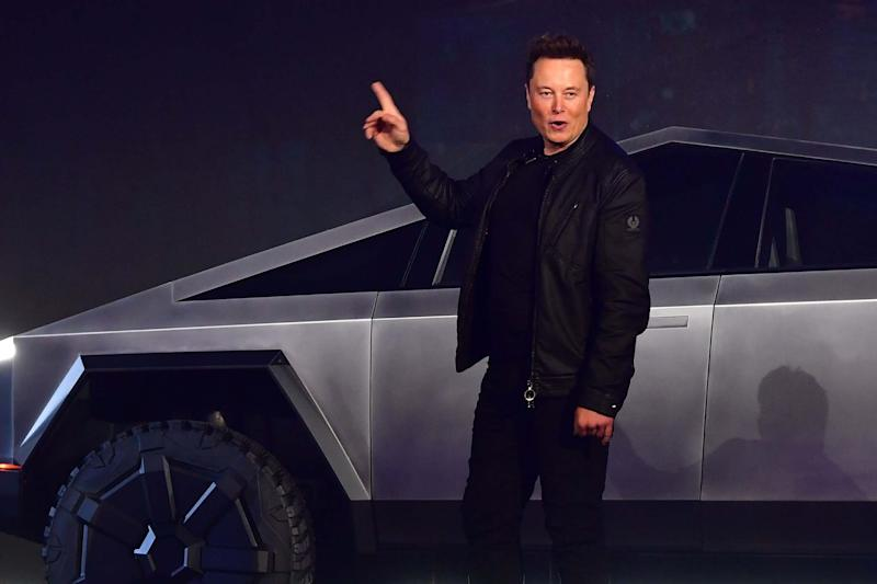 Tesla co-founder and CEO Elon Musk gestures while introducing the newly unveiled all-electric battery-powered Tesla Cybertruck (AFP via Getty Images)