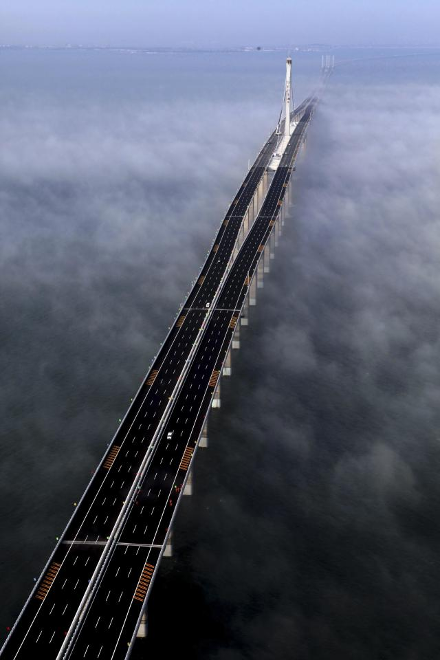This photo taken Wednesday, June 29, 2011 released by China's Xinhua news agency shows the Jiaozhou Bay Bridge in Qingdao, east China's Shandong Province. China opened Thursday, June 30, 2011, the world's longest cross-sea bridge, which is 42 kilometers (26 miles) long and links China's eastern port city of Qingdao to an offshore island, Huangdao. (AP Photo/Xinhua, Yan Runbo) NO SALES