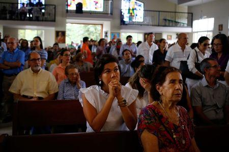 People attend mass at the Divine Mercy Catholic Church, which was the church where student protesters took refuge in after coming under gunfire from armed pro-government supporters on July 14, in Managua, Nicaragua, July 20, 2018. REUTERS/Oswaldo Rivas