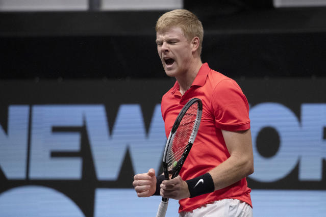 Kyle Edmund, of Britain, rects as he wins the first set against Andreas Seppi, of Italy, in the finals of the New York Open tennis tournament, Sunday, Feb. 16, 2020, in Uniondale, N.Y. (AP Photo/Mark Lennihan)