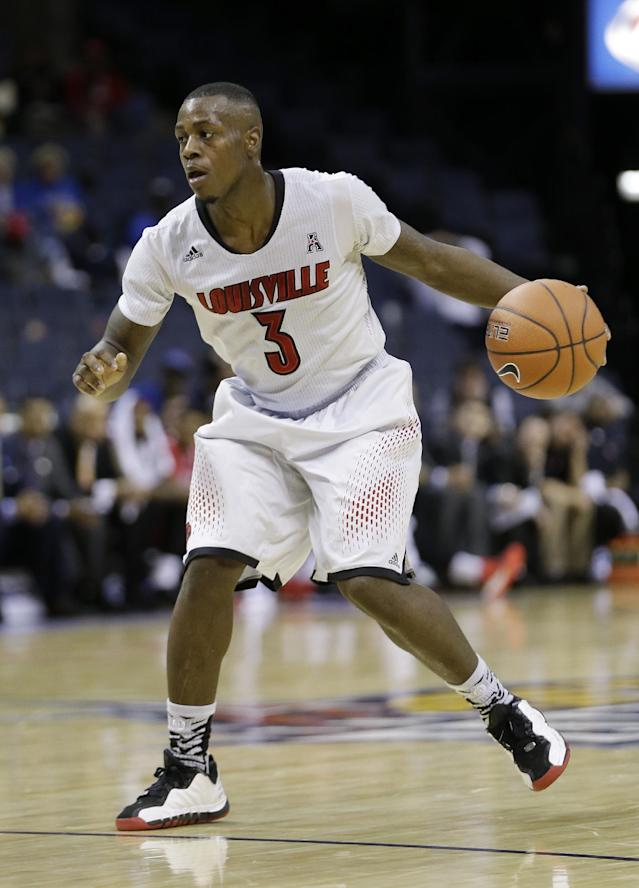 Louisville guard Chris Jones plays against Rutgers in the second half of an NCAA college basketball game during the quarterfinals of the American Athletic Conference tournament on Thursday, March 13, 2014, in Memphis, Tenn. Jones had 18 points as Louisville won 92-31. (AP Photo/Mark Humphrey)
