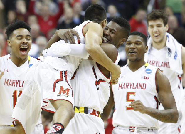 Mar 20, 2015; Columbus, OH, USA; Maryland Terrapins forward Jonathan Graham (25) hugs guard Varun Ram (21, left) after the game against the Valparaiso Crusaders in the second round of the 2015 NCAA Tournament at Nationwide Arena. Maryland won 65-62. (Joe Maiorana-USA TODAY Sports)