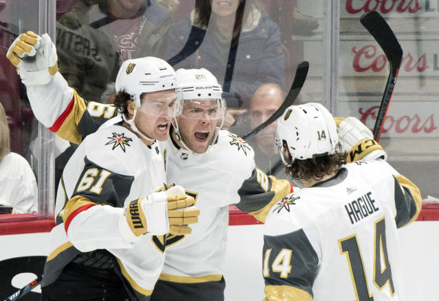 Vegas Golden Knights' Paul Stastny (26) celebrates with teammates Mark Stone (61) and Nicolas Hague after scoring during second-period NHL hockey game action against the Montreal Canadiens in Montreal, Saturday, Jan. 18, 2020. (Graham Hughes/The Canadian Press via AP)